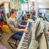Music major Kaylie Wiltersen practices the keyboard in her Skarland Hall single room.  Filename: LIF-13-3735-79.jpg