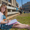 UAF student Kaylee Miltersen works on her homework in the April sunshine outside the library.  Filename: LIF-12-3356-81.jpg