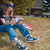 Cameron Simmons studies while enjoying some nice weather on campus after a long winter.  Filename: LIF-12-3356-11.jpg