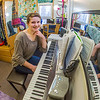 Music major Kaylie Wiltersen practices on her keyboard in her Skarland Hall single room.  Filename: LIF-13-3735-85.jpg