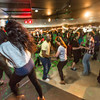 """Students learn some new steps during a Latin Dance evening in the Wood Center Pub, one of many events in the 2014 UAF Winter Carnival.  <div class=""""ss-paypal-button"""">Filename: LIF-14-4086-14.jpg</div><div class=""""ss-paypal-button-end"""" style=""""""""></div>"""