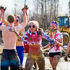 Kelly McGinley celebrates after winning a round of mud volleyball during the 2012 Spring Fest activities.  Filename: LIF-12-3378-68.jpg