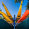 Canoes and kayaks rest on racks near UAF's Wood Center when not being used by the Outdoor Adventures program.  Filename: LIF-12-3476-20.jpg