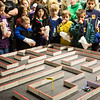 With bags of popcorn on hand, youngsters watch an electronic mouse navigate a labyrinth during the E-Week open house in the Duckering Building.  Filename: LIF-13-3741-33.jpg