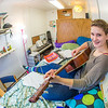 Music major Kaylie Wiltersen practices the guitar in her Skarland Hall single room.  Filename: LIF-13-3735-55.jpg