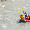 "Students and staff members raise their paddles in triumph after navigating a stretch of white water on a raft trip down the Nenana River led by UAF Outdoor Adventures in June, 2014.  <div class=""ss-paypal-button"">Filename: OUT-14-4211-418.jpg</div><div class=""ss-paypal-button-end""></div>"
