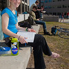 Rebekah Tsigonis goes barefoot while enjoying some nice weather outside on campus after a long winter.  Filename: LIF-12-3356-47.jpg
