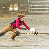 "UAF graduate student Ludda Ludwig makes a save in net during a wet and muddy soccer match on a summer night at the Toolik Field Station on Alaska's North Slope.  <div class=""ss-paypal-button"">Filename: LIF-14-4216-132.jpg</div><div class=""ss-paypal-button-end""></div>"