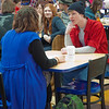 "Stephanie Sundberg, left, and Tyler McClendon perform a little ""flash theater"" by running a scene from Theatre UAF's production of ""All in the Timing"" during a busy time in the Wood Center food court.  Filename: LIF-12-3325-38.jpg"