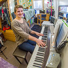 Music major Kaylie Wiltersen practices the keyboard in her Skarland Hall single room.  Filename: LIF-13-3735-82.jpg