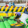 "Students took turns getting knocked around on one of the many attractions brought to campus during SpringFest Field Day on April 28.  <div class=""ss-paypal-button"">Filename: LIF-14-4168-97.jpg</div><div class=""ss-paypal-button-end""></div>"
