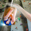 Miriam Brooks practices her silk climbing skills on the climbing wall in the SRC.  Filename: LIF-13-3819-80.jpg