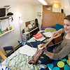 Music major Kaylie Wiltersen practices on her guitar in her Skarland Hall single room.  Filename: LIF-13-3735-48.jpg
