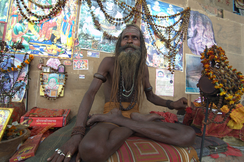 Holy man (sadhu) that hangs out on the banks of the Ganges in Varanasi, India.  He reads holy scriptures and smokes ganja all day.
