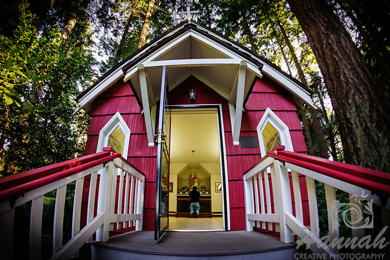 "A man praying at St. Anne's Chapel at ""The Grotto"" in Portland, Oregon  © Copyright Hannah Pastrana Prieto"
