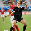 England's defender Rachel Williams (left) holds off a challenge from New Zealand's Bridgette Armstrong in a qualifying match during the FIFA U-20 Women's World Cup in Santiago, Chile (2008).