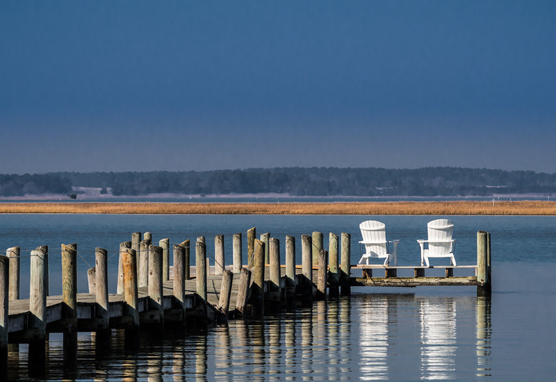Two White Chairs on Dock
