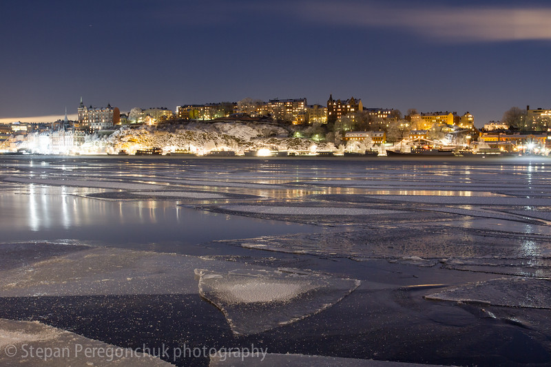 Icy lake at Södermalm at winter night