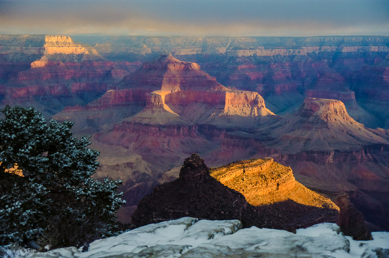 Early morning sunlit makes the rock formations glow golden in the Grand Canyon National Park in Arizona.