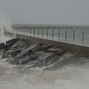 Wave crashing into Two Harbors breakwall.