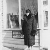 Ethel Loomer in front of Loomer's Confectionary in Bruderheim AB