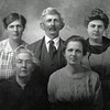 Taken some years later than the photo above with their sons, this image shows an older David A. Durham with his wife, Allie (Norman) Durham, seate at left.  Beside her is daughter Nora.  The two daughters standing in back are Leota Irene and Martha (Mattie).