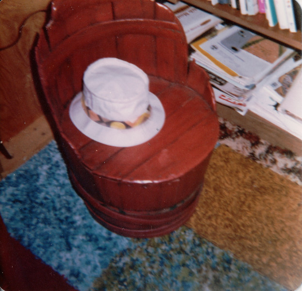 Uncle Elmer's hat on Red Barrel Chair Dad had as a baby at hatetoquitit