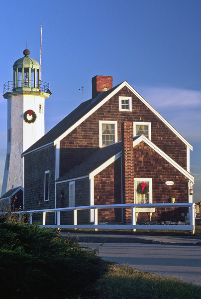 Olde Scituate Lighthouse with Christmas wreaths in early winter with no snow, Scituate, MA.