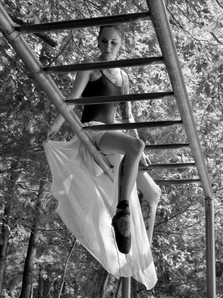 """Playground""<br /> I simply adore this photo. My model was taking a break, smoking a cigarette on top the monkey bars, looking for a stain in her skirt. Simple elegance :)"