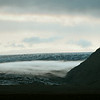 Fog rolling down the flank of the Skeiðarárjökull glacier at dusk, Iceland