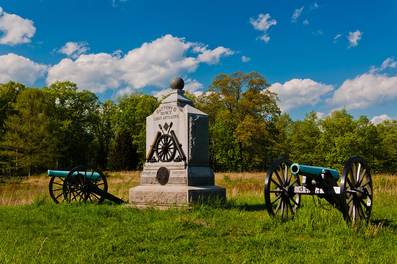 Cannons and a monument on the battlefield at Gettysburg, Pennsylvania.