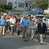 DESI SMITH/Staff photo.   Family members of Gloucester Fishermen, carry oars in their memory of those lost at sea, on their way to a Gloucester Fishermen's Memorial Service held Saturday at the Man at the Wheel statue on Stacy Blvd.    August 16,2014