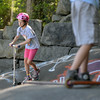 RYAN HUTTON/ Staff photo.<br /> Abby Marshall, 9, sails down a ramp at the skate park behind the Ben Beyea Youth & Teen Center.