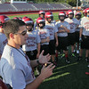 MIKE SPRINGER/Staff photo<br /> Gloucester High School head coach Tony Zerilli talks to his team during the first day of varsity football practice Monday at Newell Stadium.