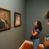 RYAN HUTTON/ Staff photo.<br /> Gina Wells, left, and her daughter Alex, right, study portraits painted by Benjamin Blyth in the newly reopened Cape Ann Museum.