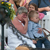 """DESI SMITH/Staff photo.   Carol Gray hold her grandson Wallace Gray III 4, as she morns the loss of her son Wallace """"Chubby"""" Gray II who was lost on the Foxy Lady II in 2012 during a Gloucester Fishermen's Memorial Service held Saturday at the Man at the Wheel statue on Stacy Blvd.    August 16,2014"""