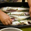 RYAN HUTTON/ Staff photo.<br /> Angela Snafilippo laying hake into olive oil and garlic.