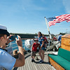 DESI SMITH/Staff photo.   O.C Alyssa Popowich from Hampton VA, takes a photo of Crystal Davis of Essex and her sons Sean 6, and Ryan 3, during their visit aboard the 295 ft Coast Guard Tall Ship Eagle, at a public open house, as part of Schooner Festival, saturday morning at Americold, next to Cruiseport in Gloucester.  August 30,2014