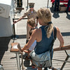 DESI SMITH/Staff photo.   O.C Brian Yannutz from Colorado, welcome visitors aboard the 295 ft Coast Guard Tall Ship Eagle, during a public open house, as part of Schooner Festival, saturday morning at Americold, next to Cruiseport in Gloucester.  August 30,2014