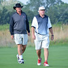 Georgia coaches Chris Haack, left, and Jim Douglas walk in the fairway during the NCAA Golf Championships at Prairie Dunes Country Club in Hutchinson, Kansas, on Monday, May 26, 2014. (Photo by Steven Colquitt)