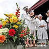 "Graduation Exercises for the Westford Academy Class of 2014, here 94 year old Genevieve Johnson gets a big hand from her ""Dream Team"" girls as she receives her diploma, L-R, Grace Gosselin, Christine Caviston and Caroline Elipoulos  .  SUN/ David H. Brow"