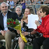 Boston Marathon bombing survivor Roseanne Sdoia returns to her seat  after speaking at Dracut High School graduation. At left is her boyfriend Mike Materia of South Boston, and at right her aunt Paula Sdoia of Dracut. (SUN/Julia Malakie)