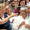 Graduation Exercises for the Westford Academy Class of 2014, here 94 year old Genevieve Johnson gets her cap fixed by her neice on far right Joyce Worrey (Bow,NH)(hands only shown) and on left is her daughter Barbara Tewell   .  SUN/ David H. Brow