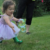 Nora trying to catch bubbles. Great outfit Nora!