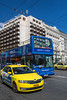Taxi and bus traffic in Syntagma Square, Athens, Greece, Europe.