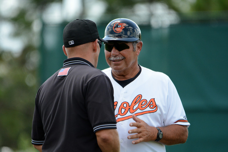 Date: 8/25/14<br /> Location: Sarasota, FL<br /> Manager Orlando Gomez confers with the HP Umpire
