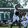 Date: 8/25/14<br /> Location: Sarasota, FL<br /> CA Alexander de la Cruz throws down the basepath as pitcher Elias Pinales crouches by