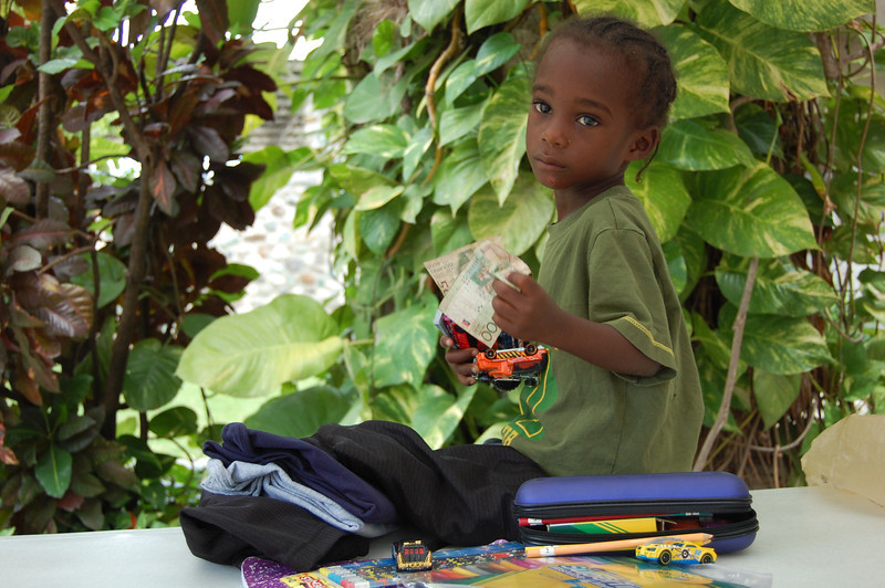 AN5362 Edmond Pierre with gift left by sponsor in Haiti