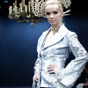 """A model walks the runway presenting  creation by Yassen Samouilov , Livia Stoianova, André de Sà Pessoa for the fashion show of On Aura Tout Vu  Fall Winter 2005-2006 during the Haute Couture Fashion Week Paris. The """"Enchanted Forest""""collection."""