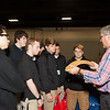 A Lockheed Martin employee tells students about what the company does and what careers are available. (Photo/Kim McManus)